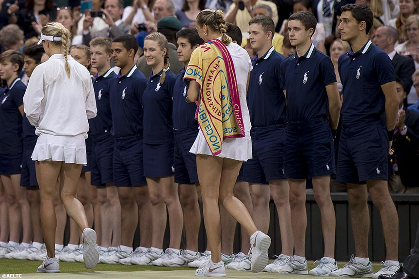 """Eugenie Bouchard and Petra Kvitova walk off court afterKvitova defeated Bouchard to win the ladies' singles final on Centre Court at the All England Lawn and Tennis Club in London, England Saturday, July 5, 2014 during the 2014 Championships Wimbledon."""
