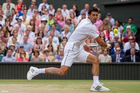 """Novak Djokovic hits a backhand during the gentlemen's singles final against Roger Federer at the All England Lawn and Tennis Club in London, England Sunday, July 6, 2014 during the 2014 Championships Wimbledon."""