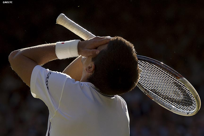 """Novak Djokovic reacts during the gentlemen's singles final against Roger Federer at the All England Lawn and Tennis Club in London, England Sunday, July 6, 2014 during the 2014 Championships Wimbledon."""