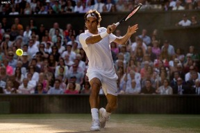 """Roger Federer hits a backhand during the gentlemen's singles final against Novak DJokovic at the All England Lawn and Tennis Club in London, England Sunday, July 6, 2014 during the 2014 Championships Wimbledon."""