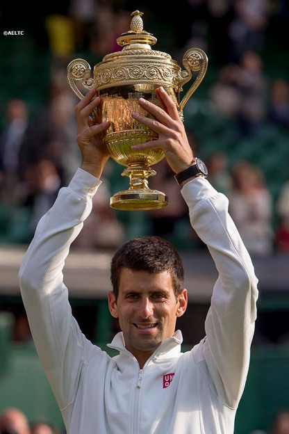 """Novak Djokovic poses with the Champion's trophy after defeating Roger Federer in the gentlemen's singles final at the All England Lawn and Tennis Club in London, England Sunday, July 6, 2014 during the 2014 Championships Wimbledon."""