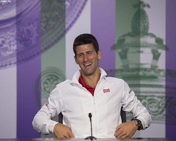 """Novak Djokovic laughs as he addresses media during a press conference after defeating Roger Federer in the gentlemen's singles final at the All England Lawn and Tennis Club in London, England Sunday, July 6, 2014 during the 2014 Championships Wimbledon."""