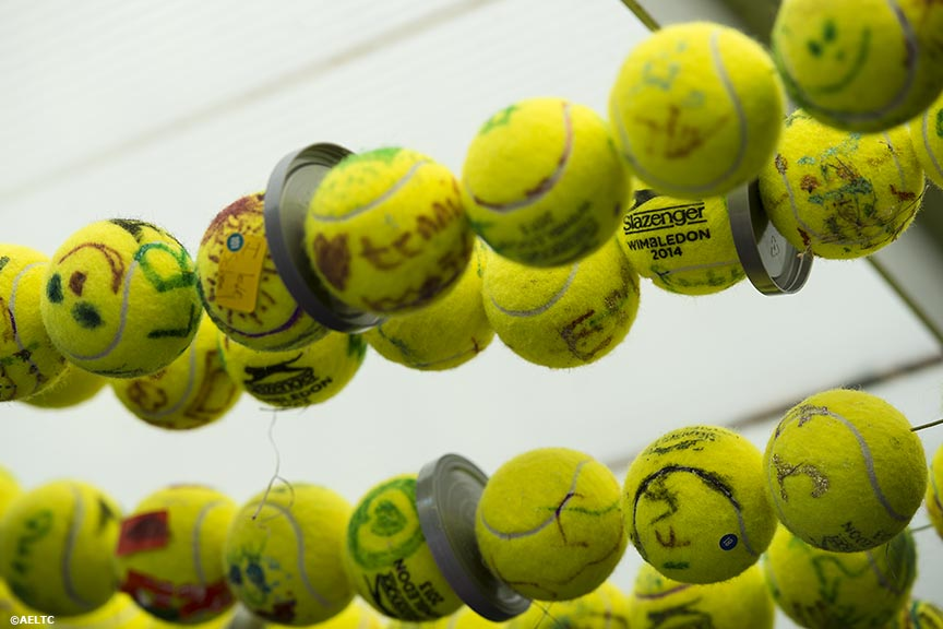 """Decorated Slazenger used championship tennis balls are shown at the All England Lawn and Tennis Club in London, England Tuesday, July 1, 2014 during the 2014 Championships Wimbledon."""