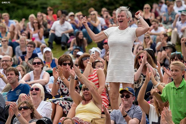 """A fan cheers as she watches a match on Henman Hill at the All England Lawn and Tennis Club in London, England Tuesday, July 1, 2014 during the 2014 Championships Wimbledon."""