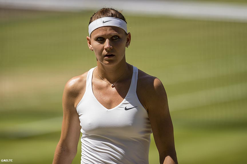 """Lucie Safarova reacts after losing a point during the Ladies' Singles Semi-Final match against Petra Kvitova on Centre Court at the All England Lawn and Tennis Club in London, England Thursday, July 3, 2014 during the 2014 Championships Wimbledon."""