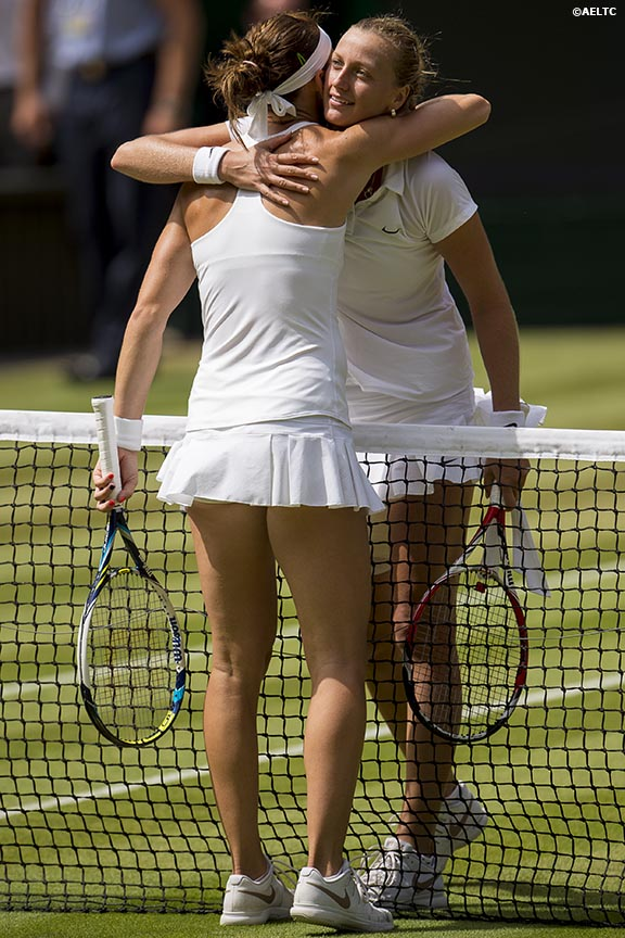 """Petra Kvitova and Lucie Safarova hug each other at the net after the Ladies' Singles Semi-Final match on Centre Court at the All England Lawn and Tennis Club in London, England Thursday, July 3, 2014 during the 2014 Championships Wimbledon."""