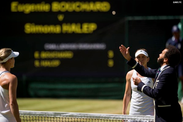 """""""Eugenie Bouchard and Simona Halep meet at the net for a coin toss before  the Ladies' Singles Semi-Final match on Centre Court at the All England Lawn and Tennis Club in London, England Thursday, July 3, 2014 during the 2014 Championships Wimbledon."""""""