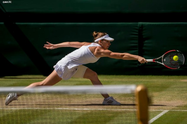"""""""Simona Halep reaches for a backhand during the Ladies' Singles Semi-Final match against Eugenie Bouchard on Centre Court at the All England Lawn and Tennis Club in London, England Thursday, July 3, 2014 during the 2014 Championships Wimbledon."""""""
