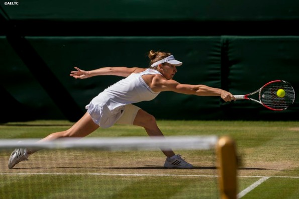 """Simona Halep reaches for a backhand during the Ladies' Singles Semi-Final match against Eugenie Bouchard on Centre Court at the All England Lawn and Tennis Club in London, England Thursday, July 3, 2014 during the 2014 Championships Wimbledon."""