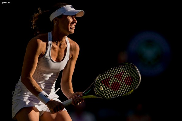 """""""Martina Hingis prepares to return a serve on Centre Court at the All England Lawn and Tennis Club in London, England Thursday, July 3, 2014 during the 2014 Championships Wimbledon."""""""