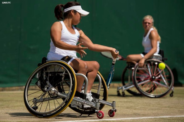 """Yui Kamiji and Jordanne Whiley play a ladies' wheelchair doubles match against Katharina Kruger and Sharon Walraven at the All England Lawn and Tennis Club in London, England Friday, July 4, 2014 during the 2014 Championships Wimbledon."""