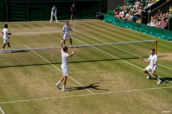 """Jack Sock and Vasek Pospisil celebrate after winning a doubles match against Leander Paes and Radek Stepanek at the All England Lawn and Tennis Club in London, England Friday, July 4, 2014 during the 2014 Championships Wimbledon."""