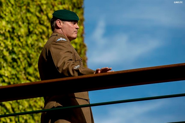 """A military guard stands on a bridge at the All England Lawn and Tennis Club in London, England Friday, July 4, 2014 during the 2014 Championships Wimbledon."""
