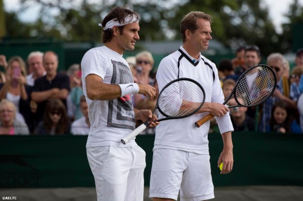 """Roger Federer chats with coach Stefan Edberg during a practice session at the All England Lawn and Tennis Club in London, England Saturday, July 5, 2014 during the 2014 Championships Wimbledon."""
