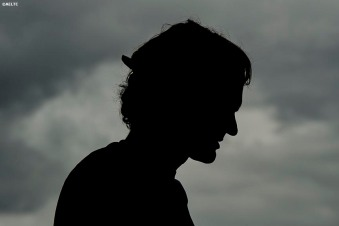 """Roger Federer is shown in silhouette during a practice session at the All England Lawn and Tennis Club in London, England Saturday, July 5, 2014 during the 2014 Championships Wimbledon."""