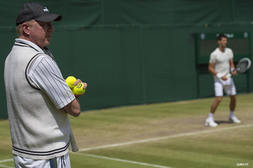"""Boris Becker watches as Novak Djokovic practices at the All England Lawn and Tennis Club in London, England Saturday, July 5, 2014 during the 2014 Championships Wimbledon."""