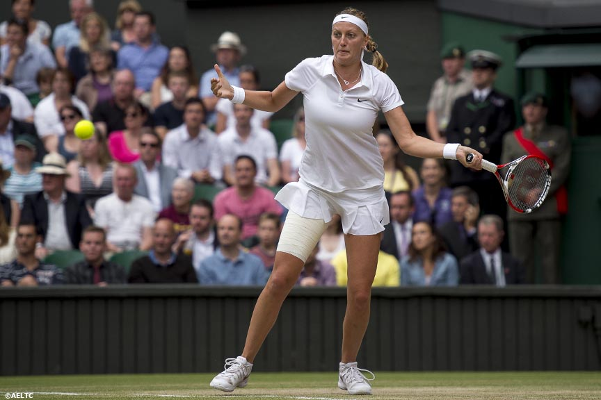 """Petra Kvitova hits a forehand during the ladies' singles final against Eugenie Bouchard on Centre Court at the All England Lawn and Tennis Club in London, England Saturday, July 5, 2014 during the 2014 Championships Wimbledon."""
