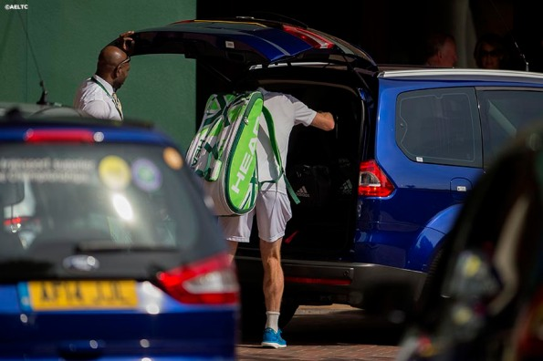 """Andy Murray puts his bags in a car as he exits the grounds of the All England Lawn and Tennis Club after losing to Grigor Dimitrov in the quarter-finals Wednesday, July 2, 2014 during the 2014 Championships Wimbledon."""