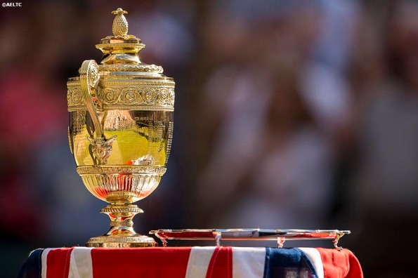 """The championship trophies are shown following the gentlemen's singles final between Novak Djokovic and Roger Federer at the All England Lawn and Tennis Club in London, England Sunday, July 6, 2014 during the 2014 Championships Wimbledon."""