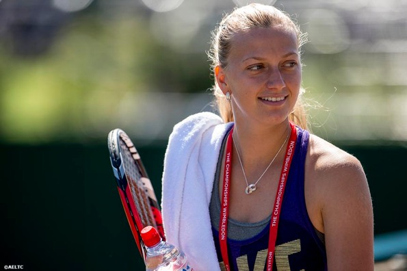 """Petra Kvitova walks towards the Aorangi practice courts before her semi-final match against Lucie Safarova at the All England Lawn and Tennis Club in London, England Thursday, July 3, 2014 during the 2014 Championships Wimbledon."""