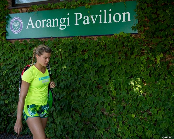 """Eugenie Bouchard walks toward the Aorangi practice courts before her semi-final match against Simona Halep at the All England Lawn and Tennis Club in London, England Thursday, July 3, 2014 during the 2014 Championships Wimbledon."""