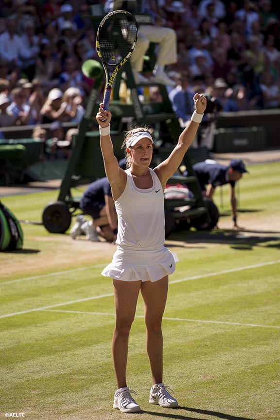 """Eugenie Bouchard reacts after defeating Simona Halep in the Ladies' Singles Semi-Final match  on Centre Court at the All England Lawn and Tennis Club in London, England Thursday, July 3, 2014 during the 2014 Championships Wimbledon."""