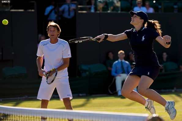 """""""A ball girl hits a volley after invitation doubles player Paul Haarhuis invited her to play a point to replace his partner at the All England Lawn and Tennis Club in London, England Thursday, July 3, 2014 during the 2014 Championships Wimbledon."""""""