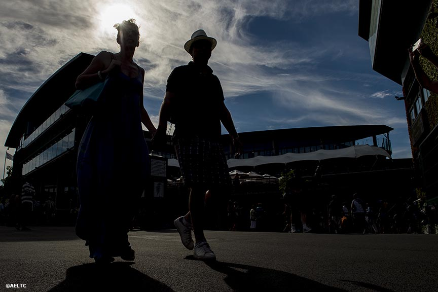 """Fans walk toward the South side of Centre Court at the All England Lawn and Tennis Club in London, England Friday, July 4, 2014 during the 2014 Championships Wimbledon."""