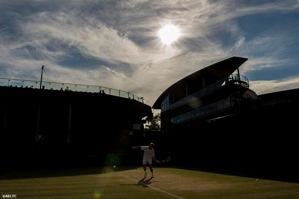 """The sun sets over the All England Lawn and Tennis Club in London, England Friday, July 4, 2014 during the 2014 Championships Wimbledon."""