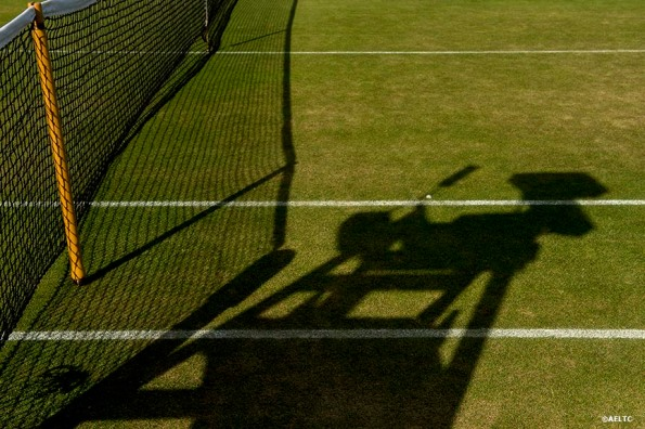 """The shadow of an umpire's chair is shown at the All England Lawn and Tennis Club in London, England Friday, July 4, 2014 during the 2014 Championships Wimbledon."""
