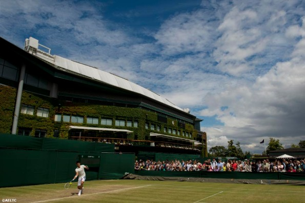 """Novak Djokovic hits a forehand during a practice session at the All England Lawn and Tennis Club in London, England Saturday, July 5, 2014 during the 2014 Championships Wimbledon."""