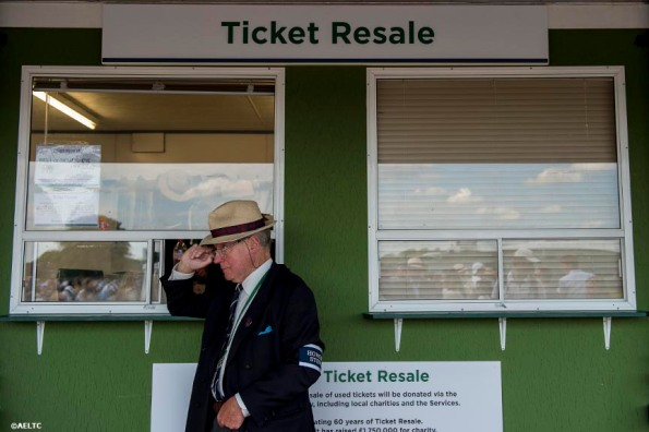 """An honorary steward stands outside the ticket resale booth at the All England Lawn and Tennis Club in London, England Tuesday, July 1, 2014 during the 2014 Championships Wimbledon."""