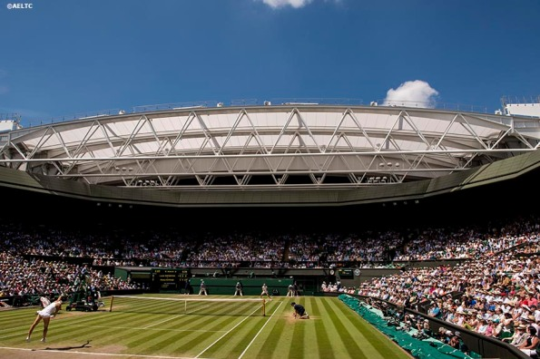 """""""Petra Kvitova and Lucie Safarova play each other in the Ladies' Singles Semi-Final match on Centre Court at the All England Lawn and Tennis Club in London, England Thursday, July 3, 2014 during the 2014 Championships Wimbledon."""""""