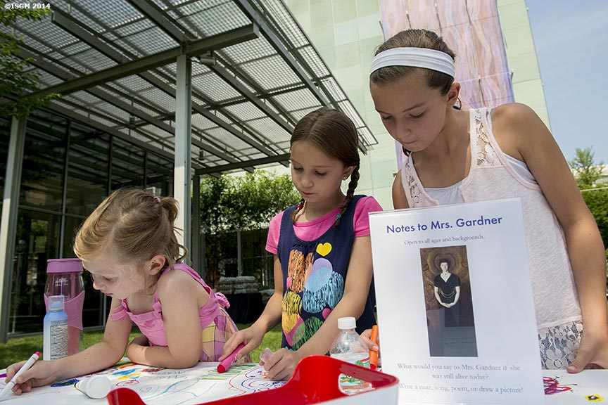 """Young guests draw and write notes to Ms. Gardner during a Free Fun Friday event sponsored by the Highland Street Foundation at the Isabella Stewart Gardner Museum in Boston, Massachusetts Friday, August 1, 2014."""