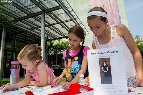 """""""Young guests draw and write notes to Ms. Gardner during a Free Fun Friday event sponsored by the Highland Street Foundation at the Isabella Stewart Gardner Museum in Boston, Massachusetts Friday, August 1, 2014."""""""
