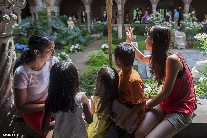 """Guests visit the courtyard during a Free Fun Friday event sponsored by the Highland Street Foundation at the Isabella Stewart Gardner Museum in Boston, Massachusetts Friday, August 1, 2014."""