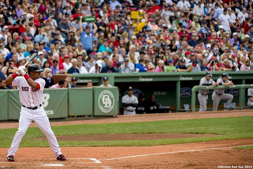 """Boston Red Sox left fielder Yoenis Cespedes gets ready during his first at bat as a member of the Boston Red Sox in the second inning of a game against the New York Yankees Saturday, August 2, 2014 at Fenway Park in Boston, Massachusetts."""