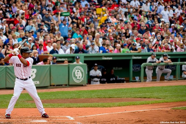 """""""Boston Red Sox left fielder Yoenis Cespedes gets ready during his first at bat as a member of the Boston Red Sox in the second inning of a game against the New York Yankees Saturday, August 2, 2014 at Fenway Park in Boston, Massachusetts."""""""