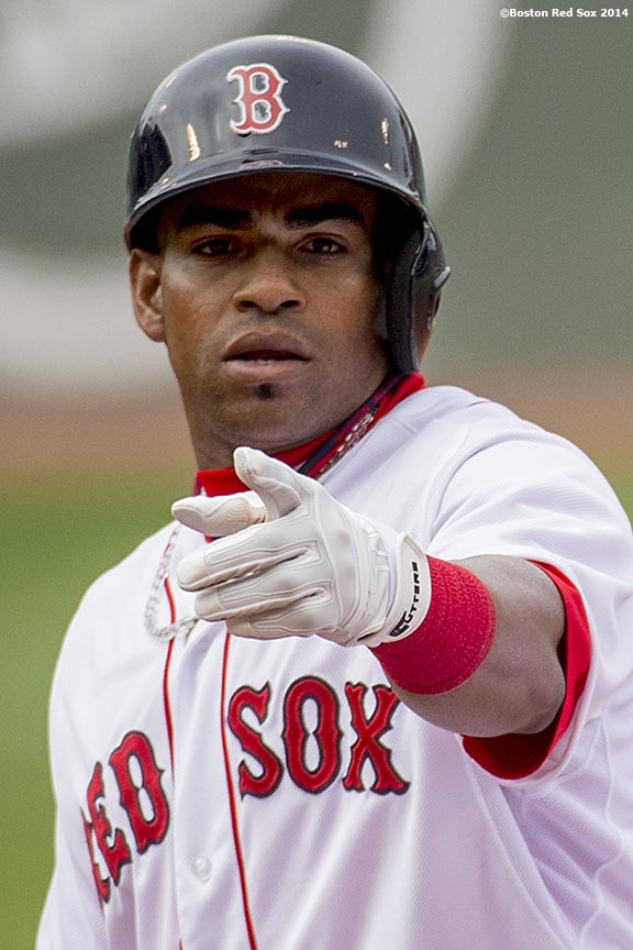 """""""Boston Red Sox left fielder Yoenis Cespedes reacts after hitting a single during his first at bat as a member of the Boston Red Sox in the second inning of a game against the New York Yankees Saturday, August 2, 2014 at Fenway Park in Boston, Massachusetts."""""""