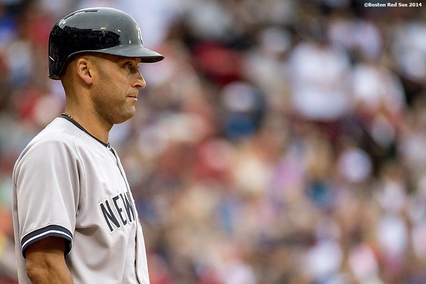 """New York Yankees shortstop Derek Jeter looks on as he bats during the first inning of a game against the Boston Red Sox Saturday, August 2, 2014 at Fenway Park in Boston, Massachusetts."""