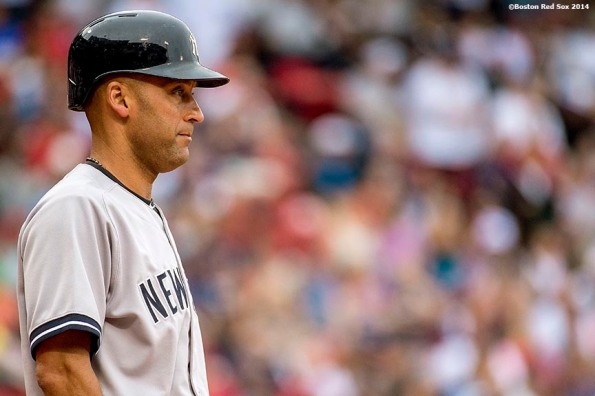 """""""New York Yankees shortstop Derek Jeter looks on as he bats during the first inning of a game against the Boston Red Sox Saturday, August 2, 2014 at Fenway Park in Boston, Massachusetts."""""""