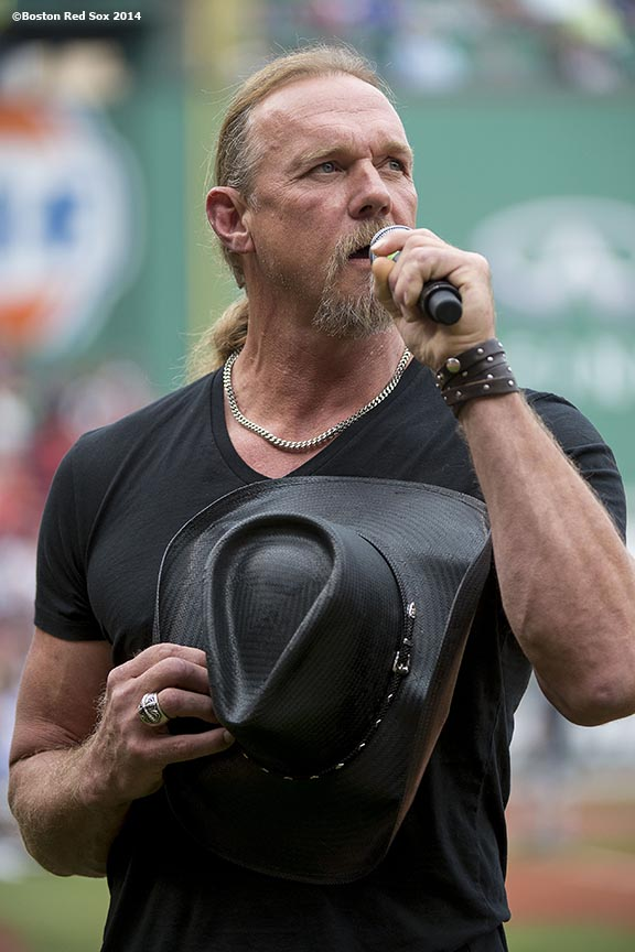 """""""Country singer Trace Adkins sings the National Anthem before a game between the Boston Red Sox and the New York Yankees Saturday, August 2, 2014 at Fenway Park in Boston, Massachusetts."""""""