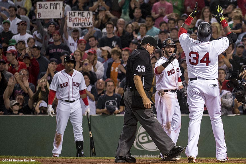 """Boston Red Sox designated hitter David Ortiz celebrates alongside second baseman Dustin Pedroia after hitting a two run home run during the fourth inning of a game against the New York Yankees Sunday, August 3, 2014 at Fenway Park in Boston, Massachusetts."""