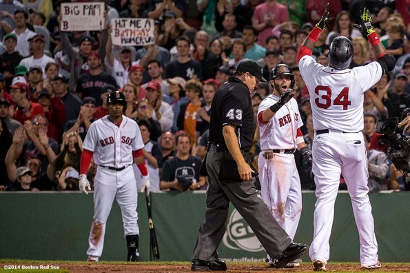 """""""Boston Red Sox designated hitter David Ortiz celebrates alongside second baseman Dustin Pedroia after hitting a two run home run during the fourth inning of a game against the New York Yankees Sunday, August 3, 2014 at Fenway Park in Boston, Massachusetts."""""""