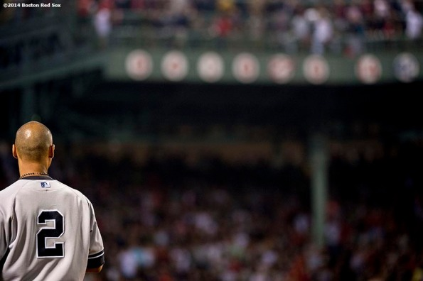 """""""New York Yankees shortstop Derek Jeter looks on toward the retired numbers during a game against the Boston Red Sox Sunday, August 3, 2014 at Fenway Park in Boston, Massachusetts."""""""