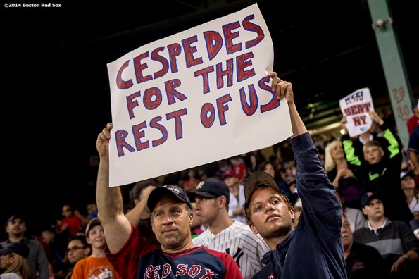 """""""Fans hold a sign reading 'Cespedes For The Rest Of Us' during a game between the Boston Red Sox and the New York Yankees Sunday, August 3, 2014 at Fenway Park in Boston, Massachusetts."""""""