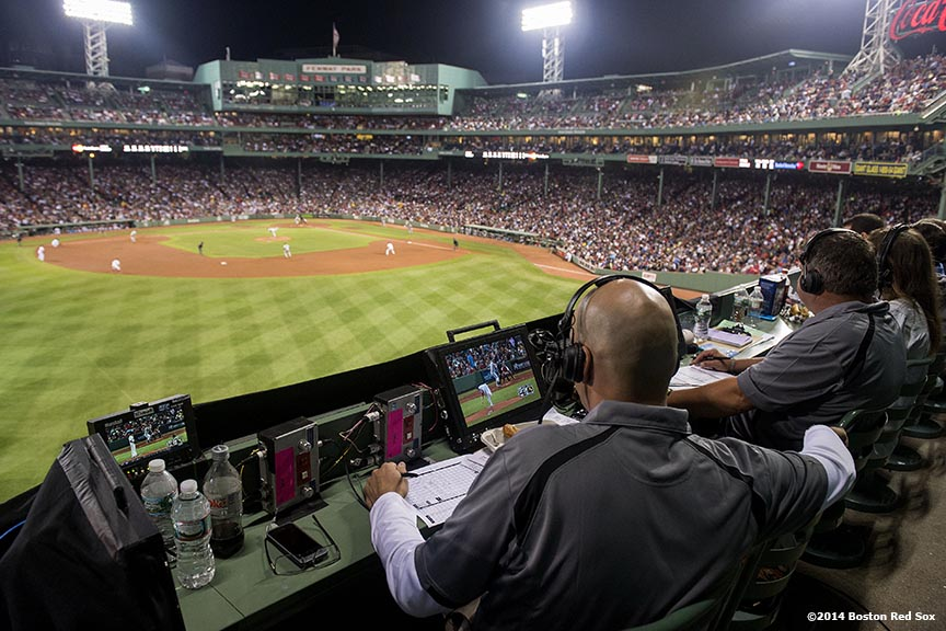 """ESPN Sunday Night Baseball announcers Dan Shulman and John Kruk broadcast from on top of the Green Monster during a game between the Boston Red Sox and the New York Yankees Sunday, August 3, 2014 at Fenway Park in Boston, Massachusetts."""