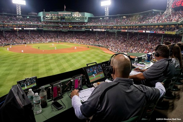 """""""ESPN Sunday Night Baseball announcers Dan Shulman and John Kruk broadcast from on top of the Green Monster during a game between the Boston Red Sox and the New York Yankees Sunday, August 3, 2014 at Fenway Park in Boston, Massachusetts."""""""