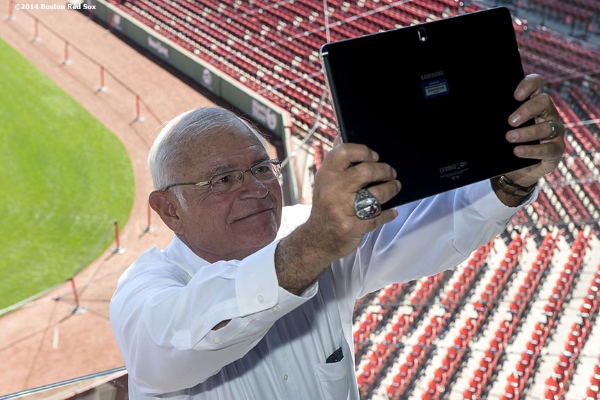 """WEEI Broadcaster and Boston Red Sox Class of 2014 Hall of Fame inductee Joe Castiglione takes a selfie in the Twitter Mirror during the 2014 Hall of Fame luncheon at Fenway Park in Boston, Massachusetts Thursday, August 14, 2014."""