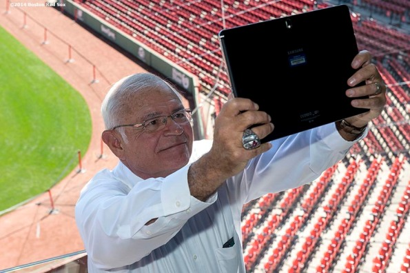 """""""WEEI Broadcaster and Boston Red Sox Class of 2014 Hall of Fame inductee Joe Castiglione takes a selfie in the Twitter Mirror during the 2014 Hall of Fame luncheon at Fenway Park in Boston, Massachusetts Thursday, August 14, 2014."""""""